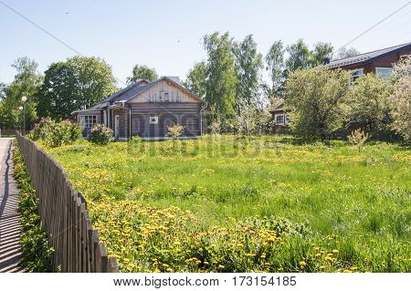 House behind the fence. Summer rural landscape the nature of central Russia.