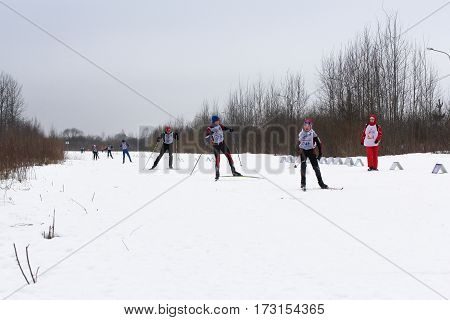 Kirishi, Russia - 11 February, People on ski reaching for each other, 11 February, 2017. Mass ski race Russian Ski Track.