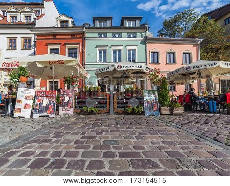 KRAKOW POLAND - 15TH OCTOBER 2016: Colourful buildings and restaurants in the Kazimierz district of Krakow. People can be seen.