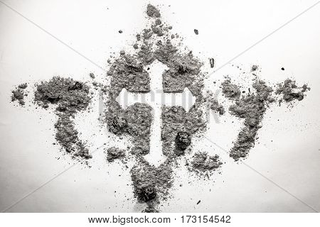 Christian cross drawing silhouette made in ash dust dirt as ash wednesday holiday old vintage retro religion symbol concept background