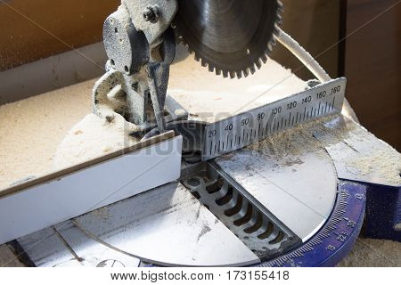 machine miter saw for precise cutting of timber