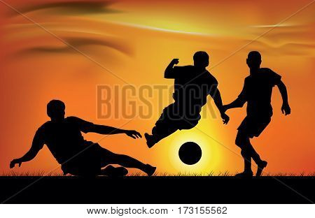 Team athletes playing soccer against the sky with sunset