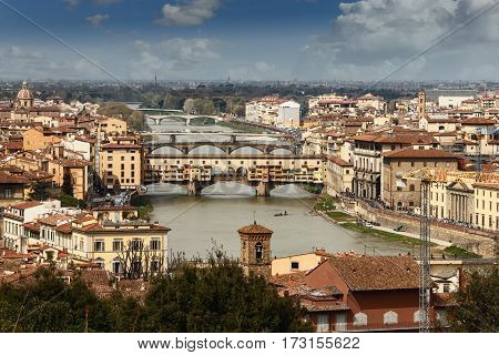 across the river Arno is spanned by several beautiful bridges the most popular with tourists the Ponte Vecchio and the Ponte Santa Trinita and Ponte alle Grazie