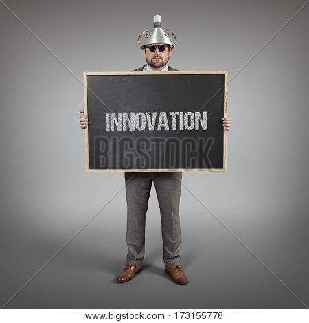 innovation text on blackboard with science businessman holding blackboard sign