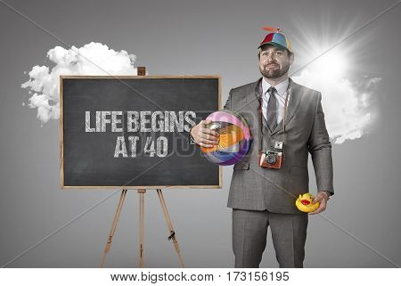 Life begins at 40 text with holiday gear businessman and blackboard with text