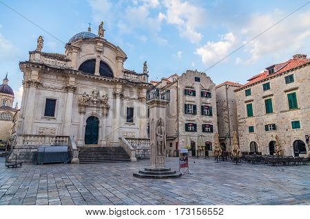 DUBROVNIK CROATIA - 11TH AUGUST 2016: A view of quiet streets in Dubrovnik during the morning. Church of Saint Blaise and other buildings can be seen.