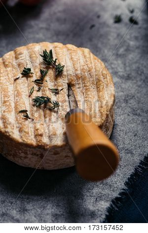 Close-up of Soft French Cheese on Rustic Table