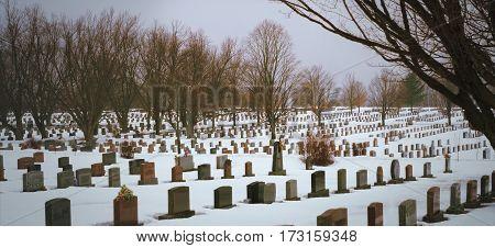 cemetery panorama stones in snow winter landscape
