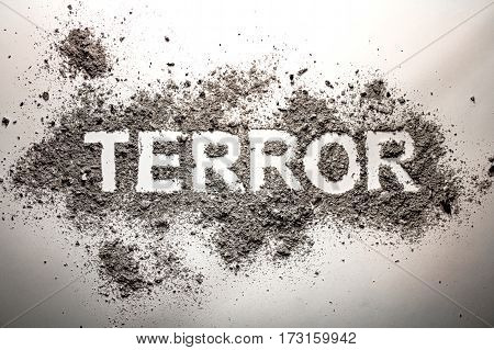 The word terror written in ash as terrorism war fear death murder bomb explosion concept