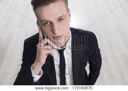 Young Blond Businessman With A Smartpone