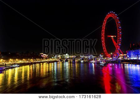 LONDON, ENGLAND - JANUARY 14, 2017 Big Eye Ferris Wheel Thames River Westminster Bridge Night Westminster London England.