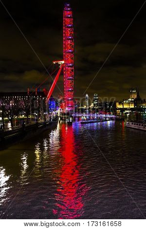 LONDON, ENGLAND - JANUARY 15, 2017 Big Eye Ferris Wheel Thames River Parliament Westminster Bridge Night Westminster London England.