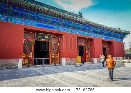 BEIJING, CHINA - 29 JANUARY, 2017: Walking around temple of heaven compund, an imperial complex with various religious buildings located in southeastern central city area, nice blue sky.