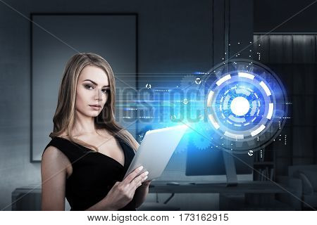 Portrait of a businesswoman with a tablet computer standing in an office with a circle and gears sketch drawn on a glassboard. Toned image.