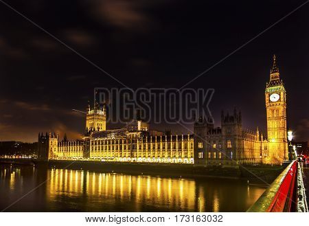 Big Ben Tower Westminster Bridge Night Thames River Houses of Parliament Westminster London England. Named after the Bell in the Tower. Has kept exact time since 1859.