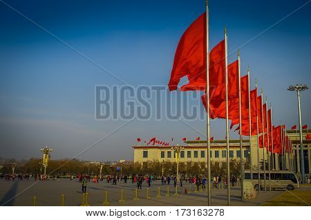 BEIJING, CHINA - 29 JANUARY, 2017: Great hall of the people, spectacular building located on Tianmen square, many red flags, beautiful blue sky.