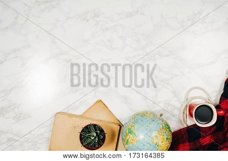 Accessories for travel top view on white natural marble background with copy space. Adventure and wanderlust concept image with accessories. Traveler preparing for an exotic trip and journey.