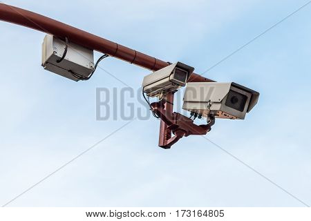 image of CCTV camera against a blue sky