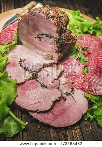 meat on a cutting board with shallow depth of field