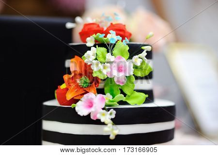 Black And White Wedding Cake Decorated With Sugar Flowers