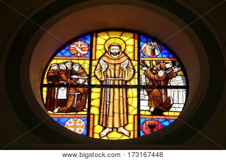 SHKODER, ALBANIA - SEPTEMBER 30: Saint Francis of Assisi, stained glass window in St Stephen's Cathedral in Shkoder, Albania on September 30, 2016.