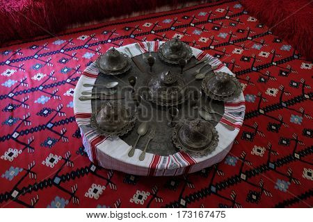 BERAT, ALBANIA - OCTOBER 01, 2016: Ethnological museum, artifacts, rug and copper,  in Berat, Albania on October 01, 2016.