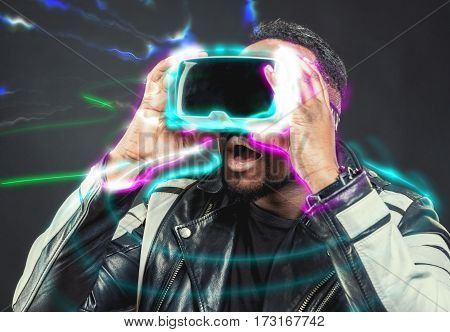 Young man wearing virtual reality VR glasses / googles.