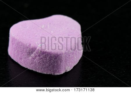 Angle View Of Blank Purple Candy Heart On Black