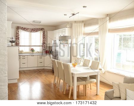 Kitchen Interior With Table And Chairs.