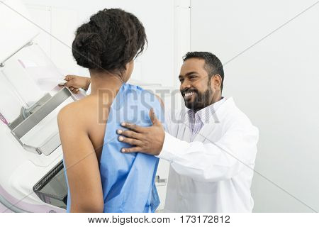 Doctor Assisting Female Patient Undergoing Mammogram X-ray Test