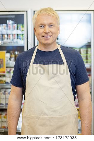 Confident Salesman Smiling In Grocery Store