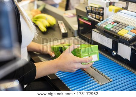 Cropped Image Of Cashier Scanning Juice Pack's Barcode