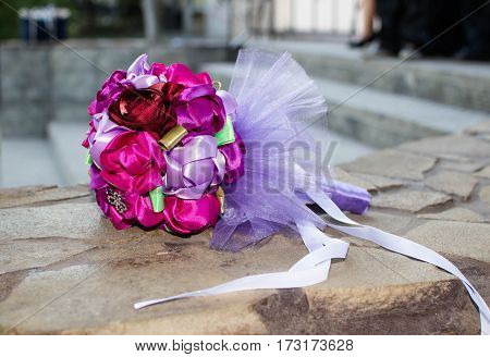 Beautiful wedding bouquet which lies on the parapet