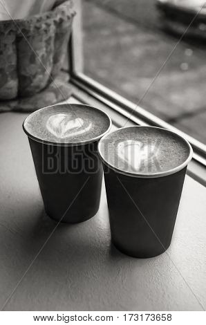 Cups of coffee standing at the window