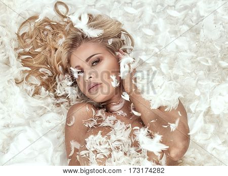 Naked Woman Lying In Feathers.