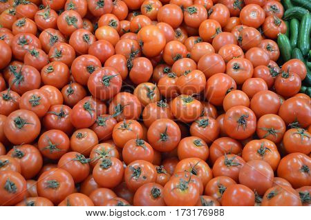 Pictures of organic and healthy tomatoes on greengrocery