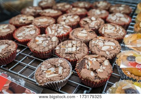 Bread or bakery on shelf staple food with a group of baked goods from dough or home cooking in store or supermarket