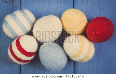 Vintage Photo, Easter Eggs Wrapped Woolen String On Blue Wooden Boards, Decoration For Easter