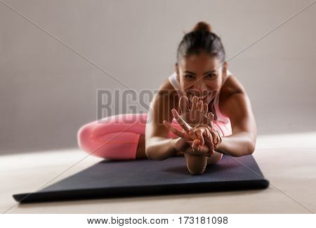 Details of the hands of a young woman show fighting practicing yoga