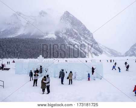 LAKE LOUISE, CANADA - FEB 19: Tourists enjoy the ice skating on frozen Lake Louise in Banff on February 19, 2017 in Alberta, Canada. Lake Louise is a famous summer and winter destination.