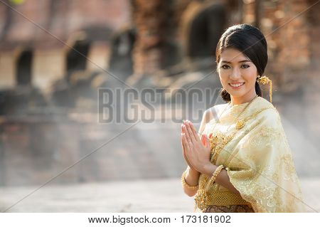 Thai Lady in vintage original Thai costume with morning time in Ayutthaya historical park Thailand