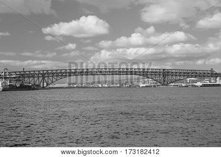 Black and White double desk bridge Red Bridge Minato Bridge over Osaka sea port Japan