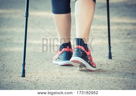 Vintage Photo, Legs Of Elderly Senior Woman Practicing Nordic Walking, Sporty Lifestyles In Old Age