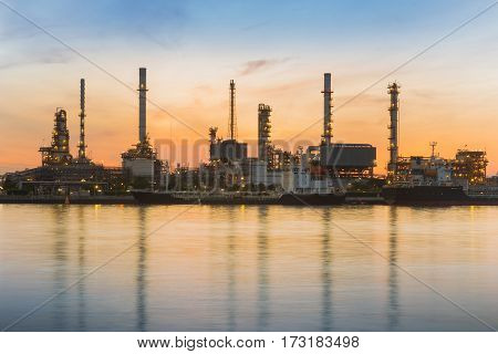 Oil refinery riverfront with water reflection with sunrise sky background industrial landscape background