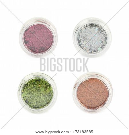 Round plastic box full of decorational sequin bits isolated over the white background, set of four different foreshortenings
