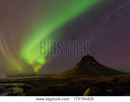 Northen light over Kirkjufell mountain with fully of star over the sky Iceland