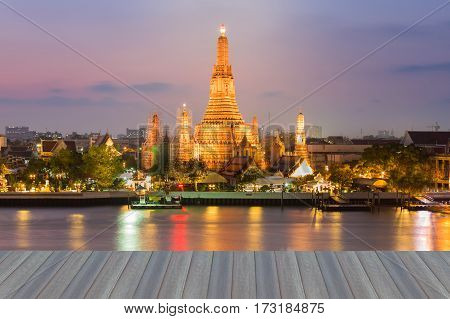 Opeining wooden floor Dramatic sky after sunset over Arun temple river front Bangkok Thailand Landmark