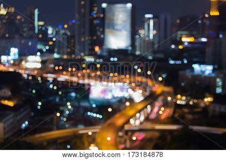 Blurred bokeh lights highway intersection aerial view abstract background
