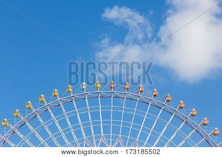 Path of observation Ferris Wheel against blue sky background