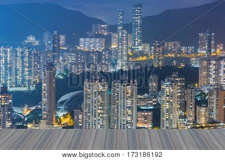 Opening wooden floor Hong Kong city apartment over high hill night view cityscape background